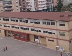 Colegio San Antonio de Catarroja (Valencia). Impermeabilización de cubierta inclinada con lamina asfáltica autoprotegida