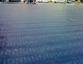 Parking en Benetusser (Valencia). Impermeabilización bajo parking de vehículos y acabada con baldosas sobre lámina impermeabilizante par